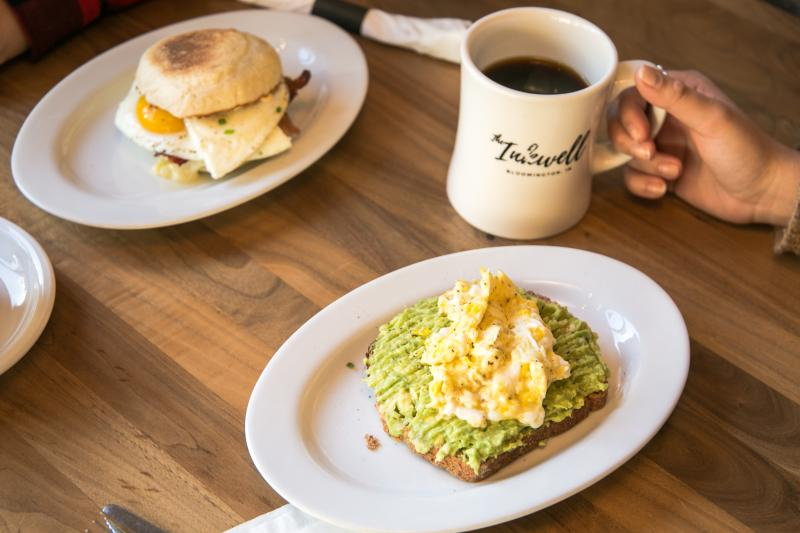 Breakfast sandwich and avocado toast from The Inkwell