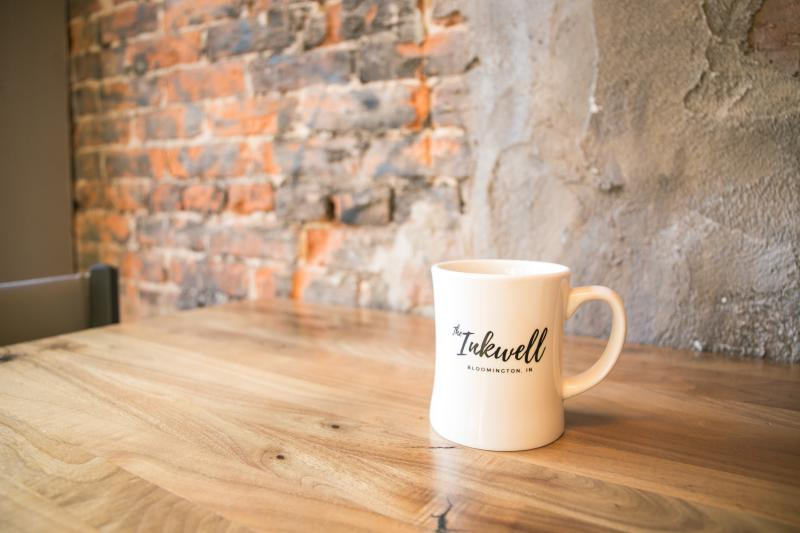 An Inkwell coffee mug sitting on a table
