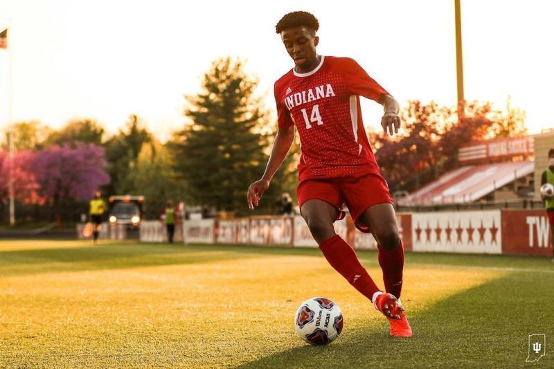 An IU soccer player kicking a soccer ball