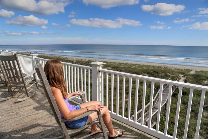 Enjoying the afternoon on the porch of a oceanfront vacation rental home