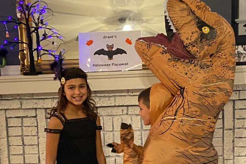 Kids dressed as a flapper and a dinosaur