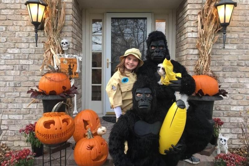 Siblings and their dog dressed in a group costume for Halloween