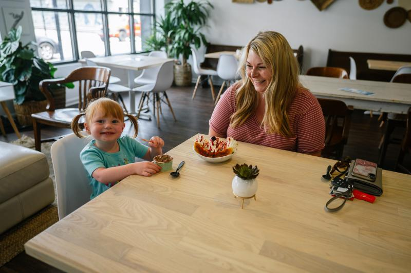 A little girl and her mother enjoying gelato at The Dreamery