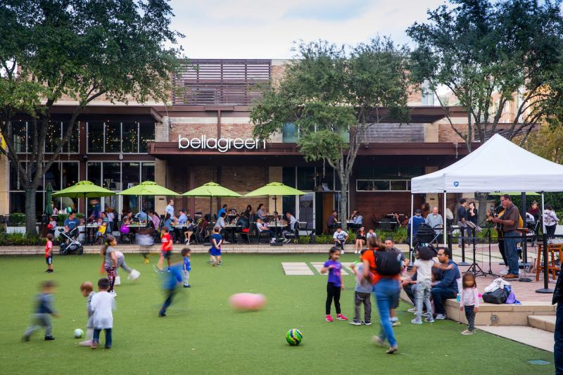 Families and children enjoy the green space at Houston's City Centre
