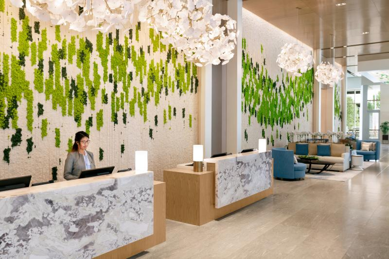 Bright colors and natural light decorate the lobby of the Intercontinental Hotel Medical Center