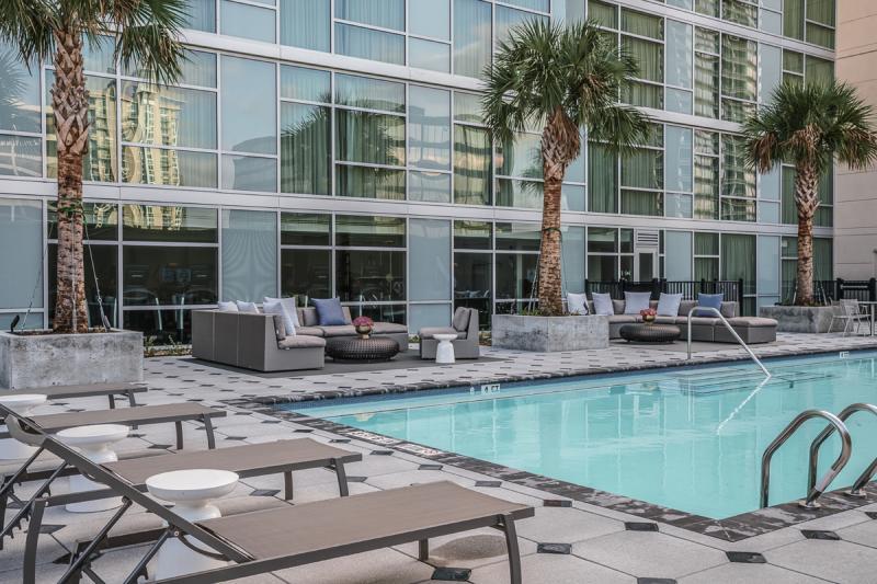 Lounge chairs line the pool at Houston's Hyatt Regency Hotel Galleria