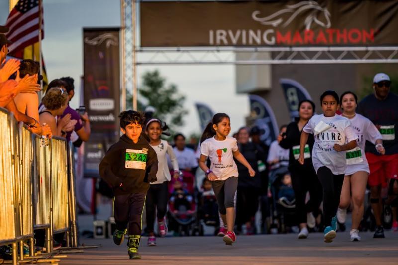 Children crossing the finish line at the Irving Marathon