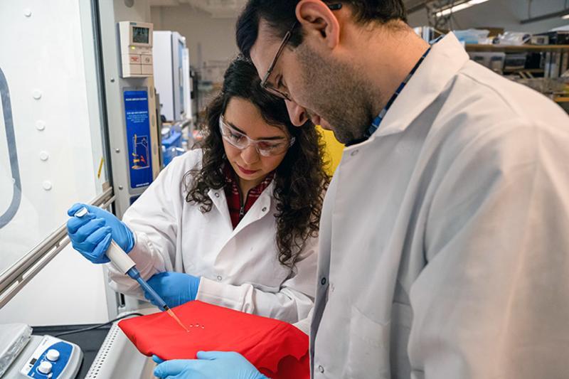 UBC Okanagan researchers Sadaf Shabanian (left) and Kevin Golovin (right) test water-repellent fabric treatment