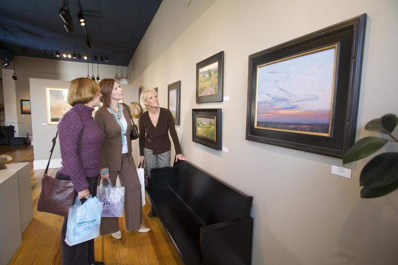 Ladies browsing art gallery