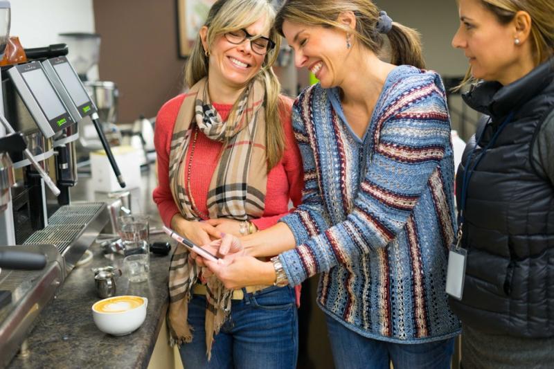 Smiling women at latte art class