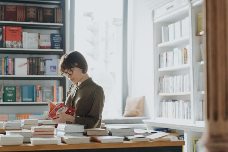 Woman checking out a book at a book store