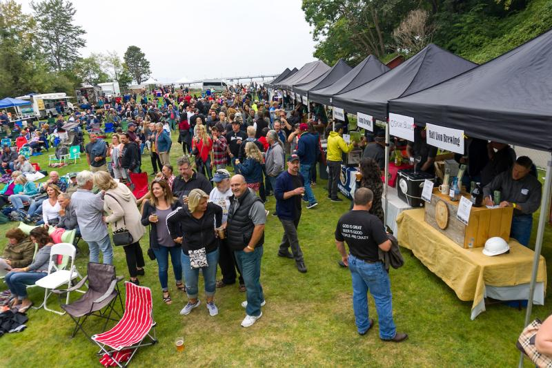 Wide view of crowd and vendor tents at Brews & Blues Festival at Des Moines Beach Park