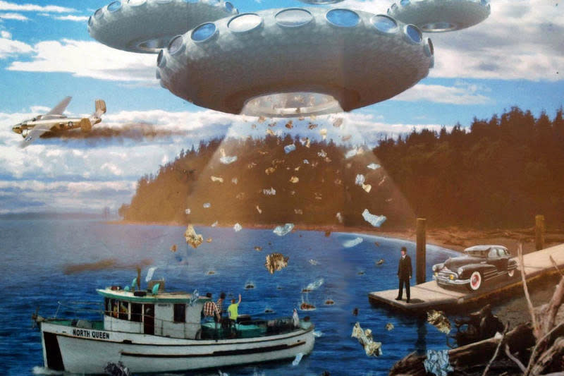 Mural of UFO over boat in Puget Sound