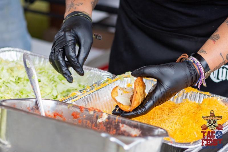 Serving Fresh Tacos at Wichita Taco Fest