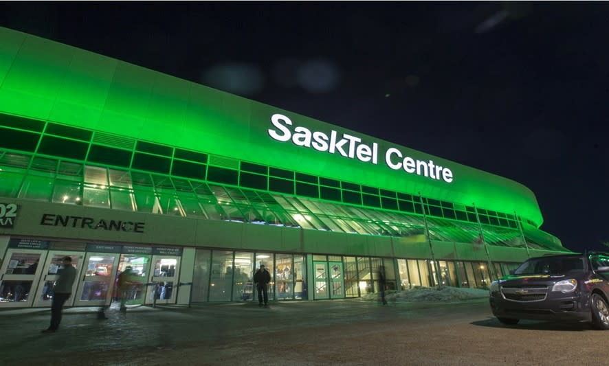 sasktel centre lit up in green
