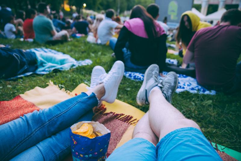 couple with laying on blankets with popcorn