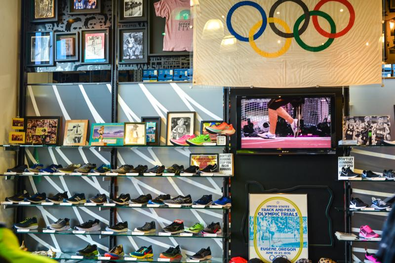 A wall of shows and Olympic memorabilia at a running store.