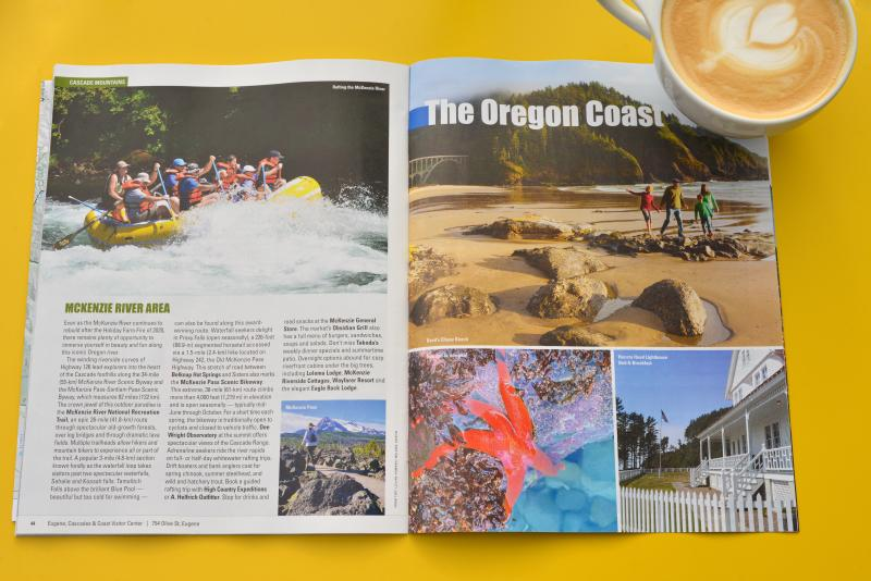 Open visitor guide on a yellow table with a latte.