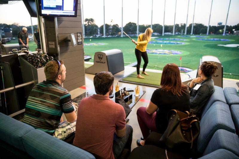 Person swinging a club at Topgolf