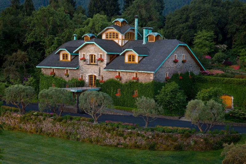 Located in Napa Valley's Oakville, Far Niente is a stone building with wood-frame windows and bright trim.