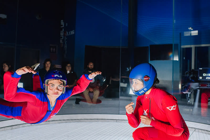 Instructor and teen defying gravity at iFly Indoor Skydiving in Tukwila