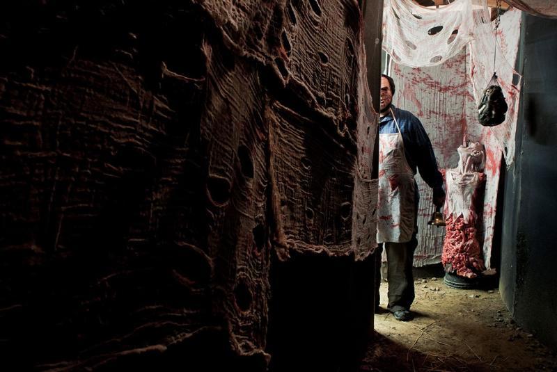 Creepy butcher standing in the Barn of Terror