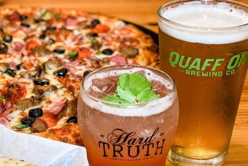 Supreme pizza, beer, and cocktail from Big Woods