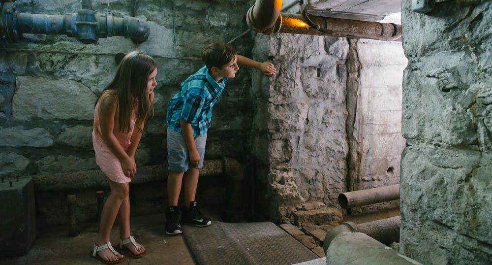 Children explore the basement of Pythian Castle