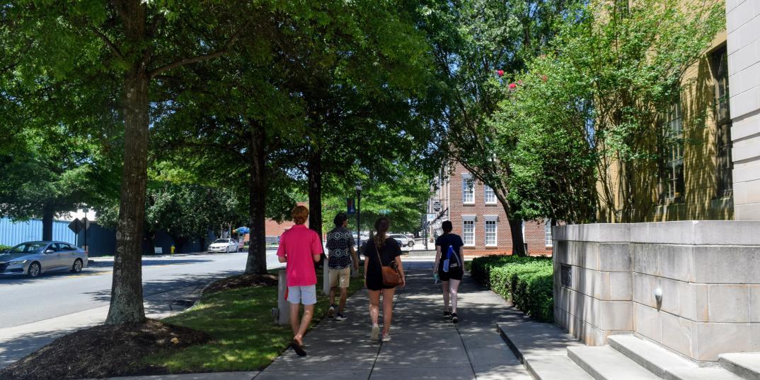 Group Of People Walking Around Downtown Cornelius, NC