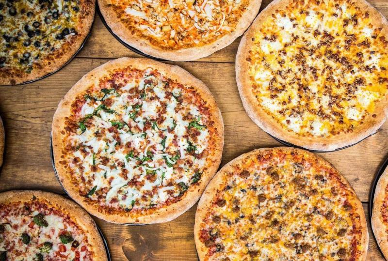 Spread of different pizzas from Pizza X