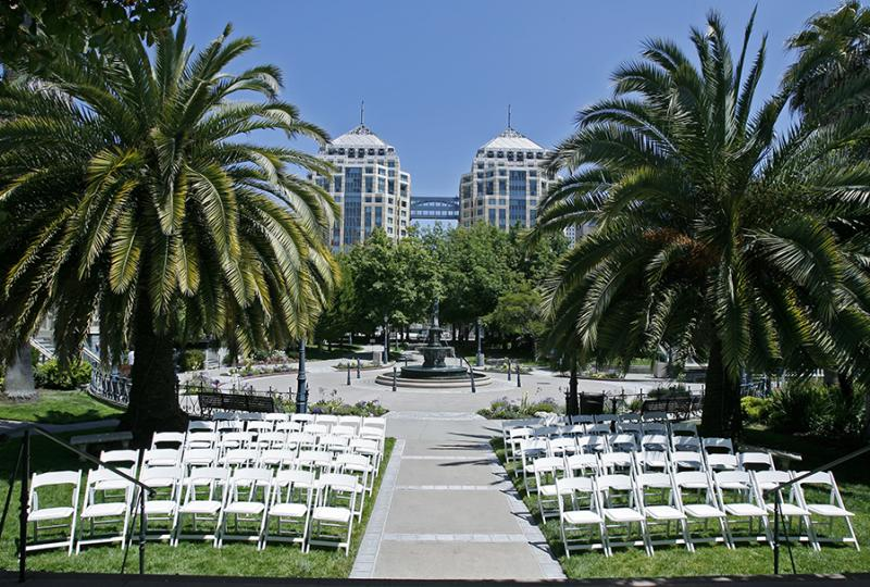 View of Preservation Park and fountain, with chairs set up for an event.