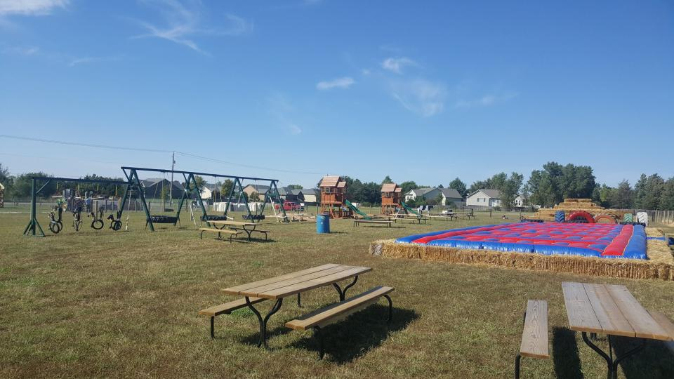 Play area and seating for Marietta Farm in Wichita, KS