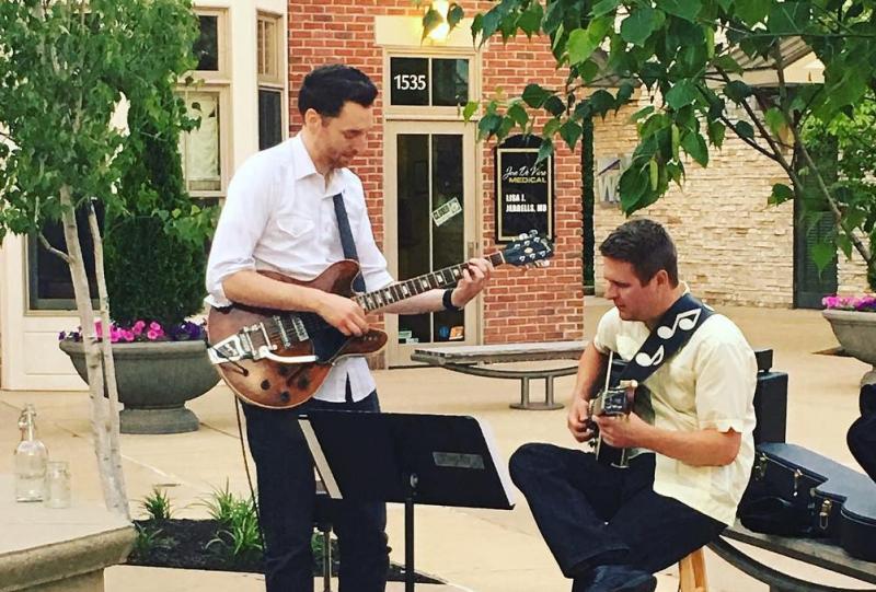 Two men playing music at C3