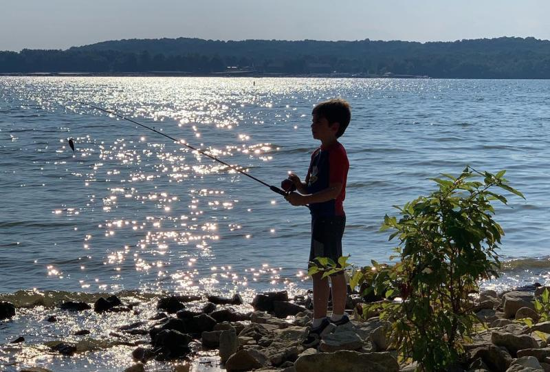 Little boy fishing at Hardin Ridge Recreation Area