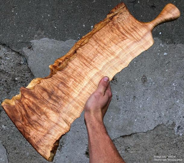 man holding board