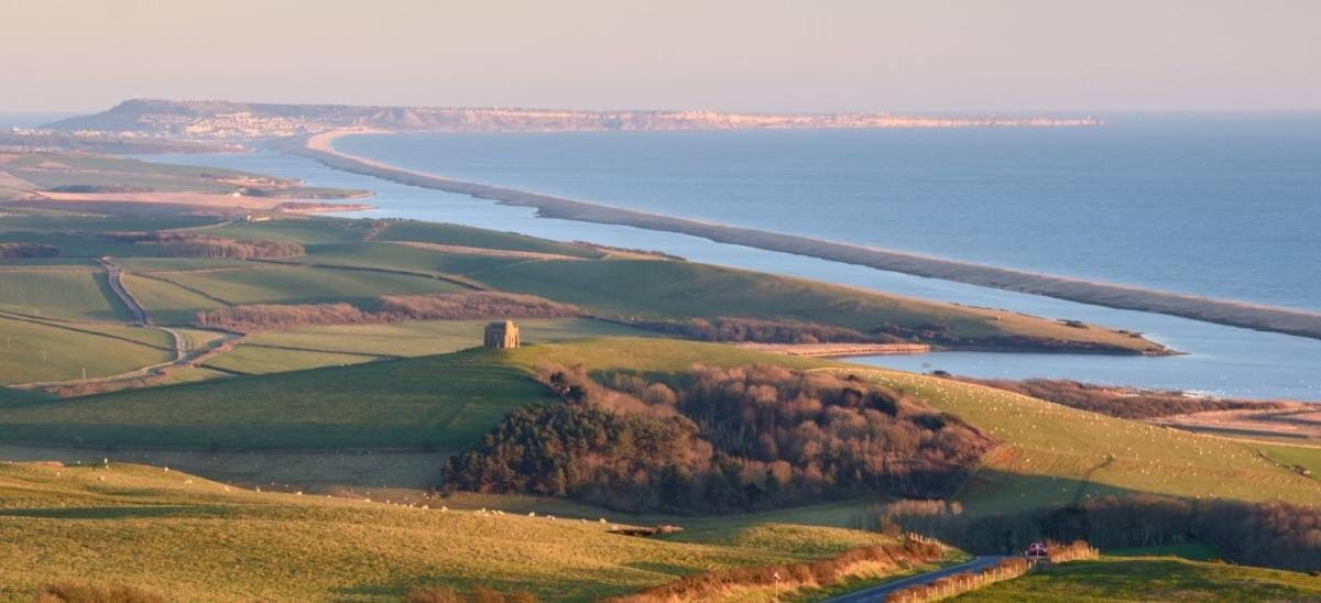 View of The Fleet lagoon and Chesil Beach from Abbotsbury in Dorset