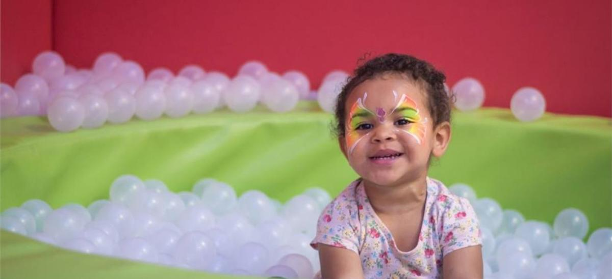 Child playing in a ball pit at Lemur Landings, Poole in Dorset