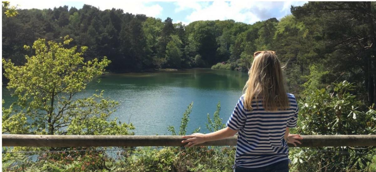 Woman looking at Blue Pool, Wareham, Dorset