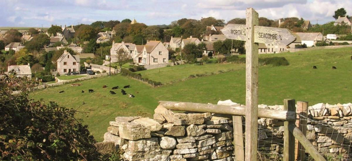Views of Worth Matravers village from the Smugglers Ways walking route in Dorset