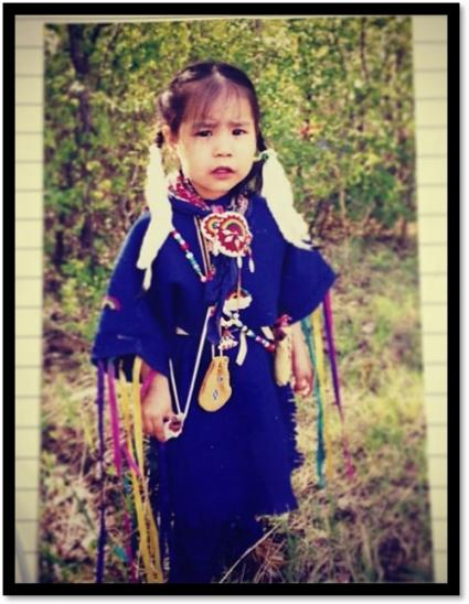 An Indigenous child dressed in regalia