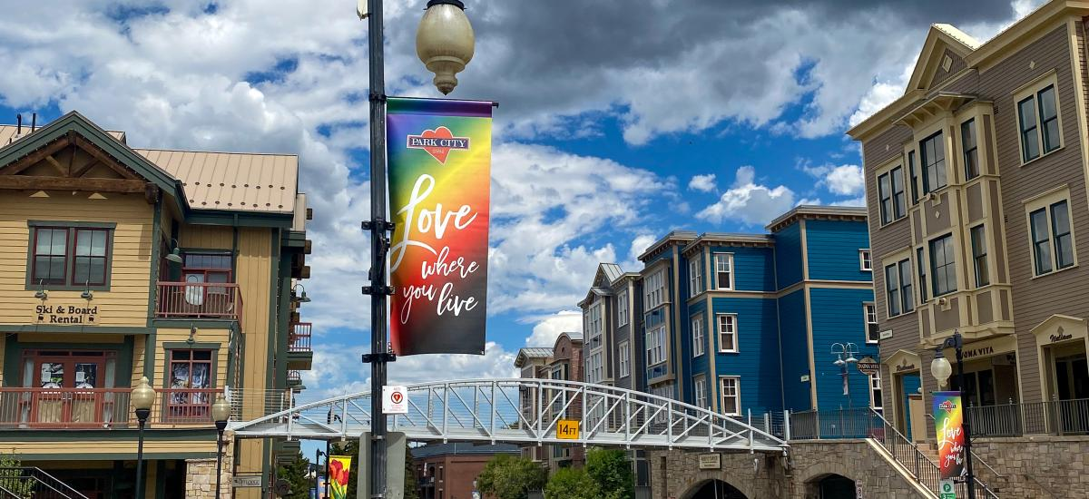 Rainbow sign that reads Love where you live