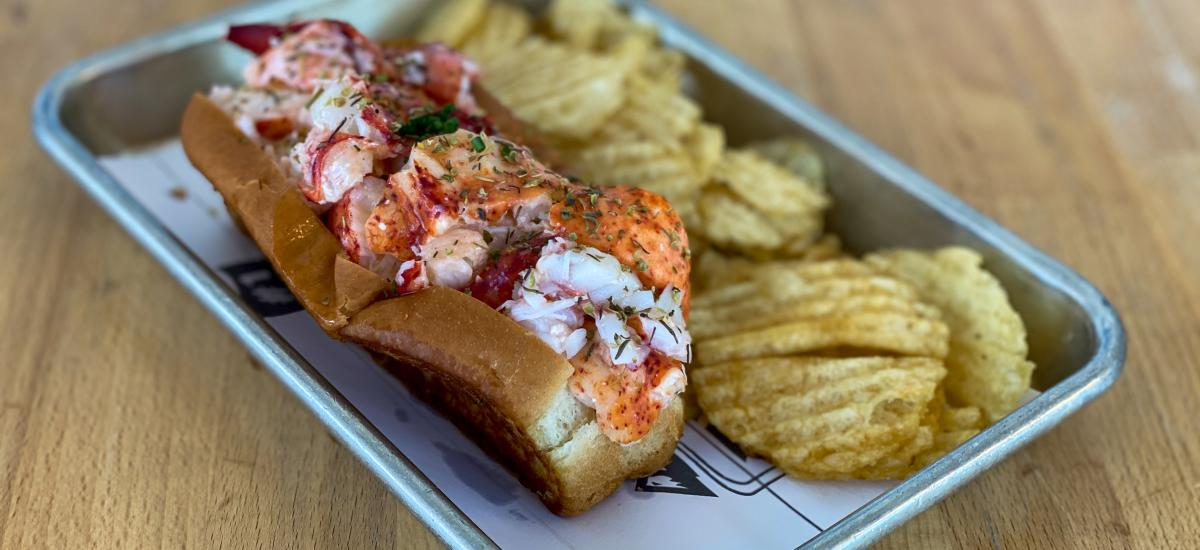 Lobster Roll and chips on a tray