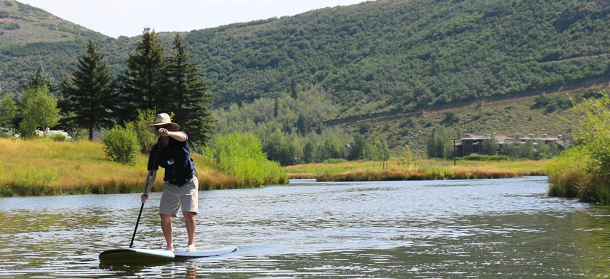 Man Stand Up Paddleboarding at Deer Valley Resort