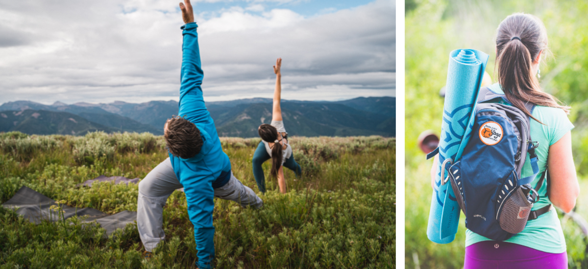 Man and woman in a yoga pose in a grassy field.