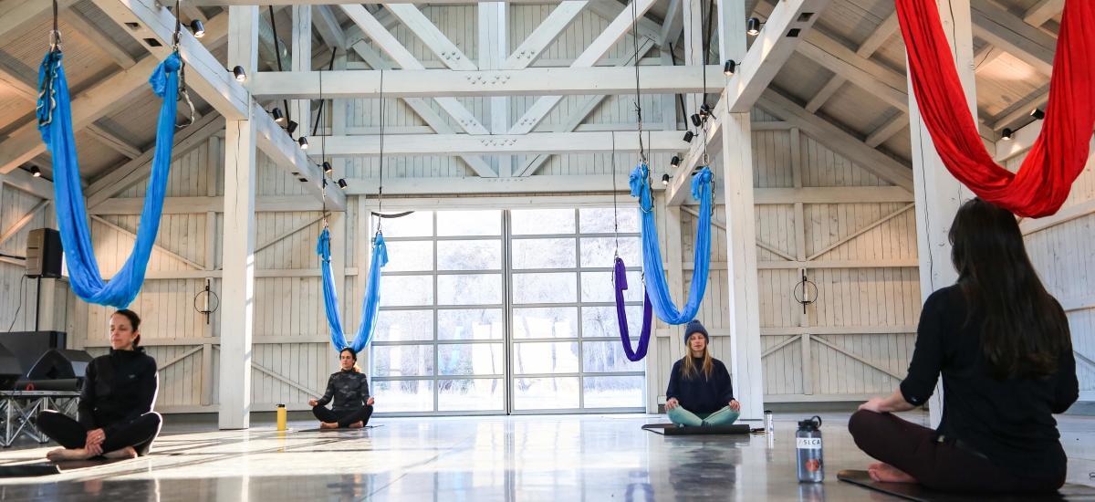 Four women sitting in a yoga class