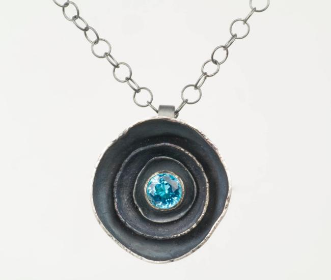 light blue stone and metal necklace from Artist Undertaking Art Gallery
