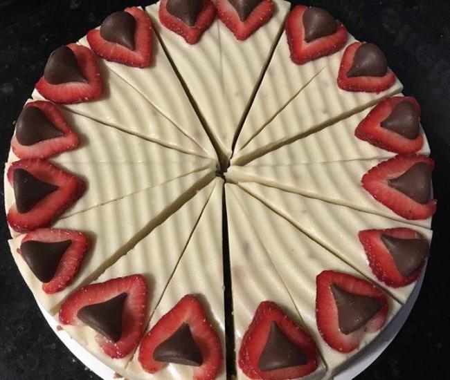 Cheesecake with strawberries and hershey kisses on top