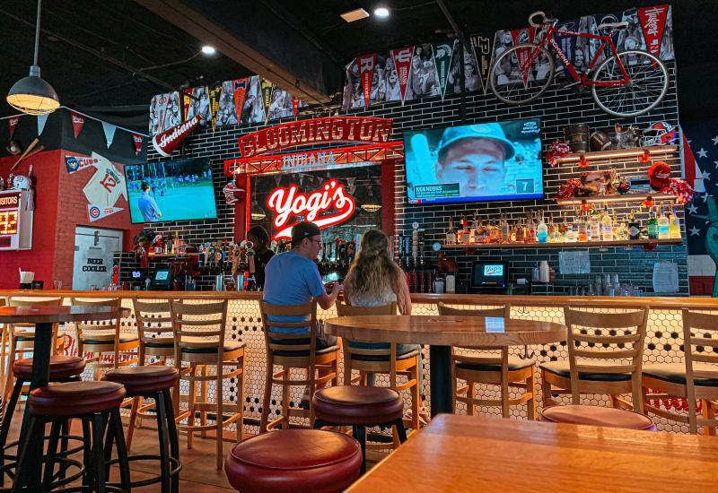 A couple sitting at the bar at Yogi's