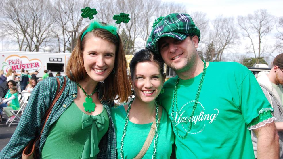 Three people dressed in all green for the Blarney Bash