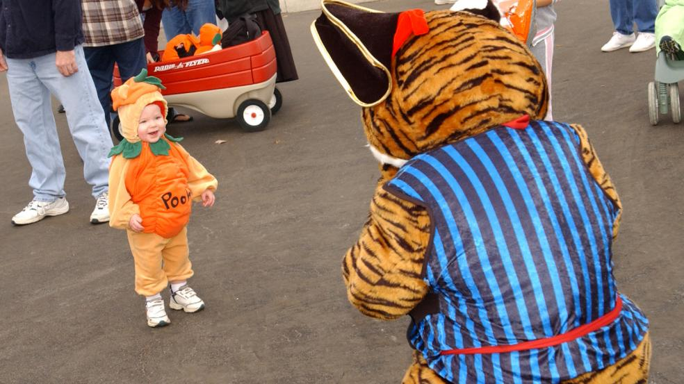 Little girl dresses as Pooh for Boo at the Columbus Zoo